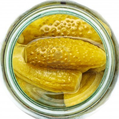 c 9040087-opened-glass-jar-of-green-pickled-cucumbers
